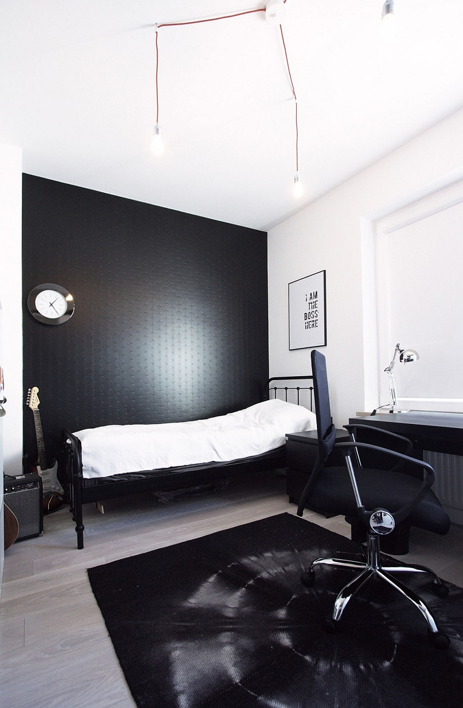 Black accent wall in the semi-minimal bedroom