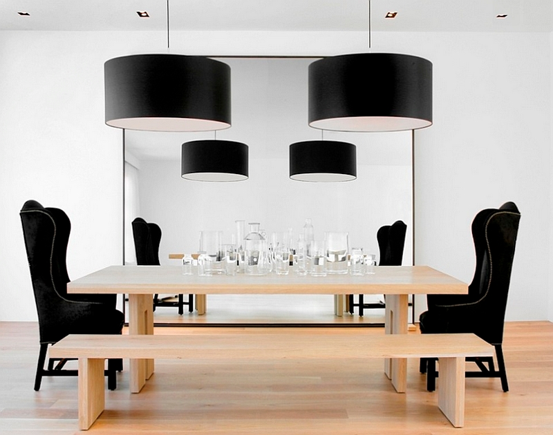 Black drum pendants bring grandeur to the dining room