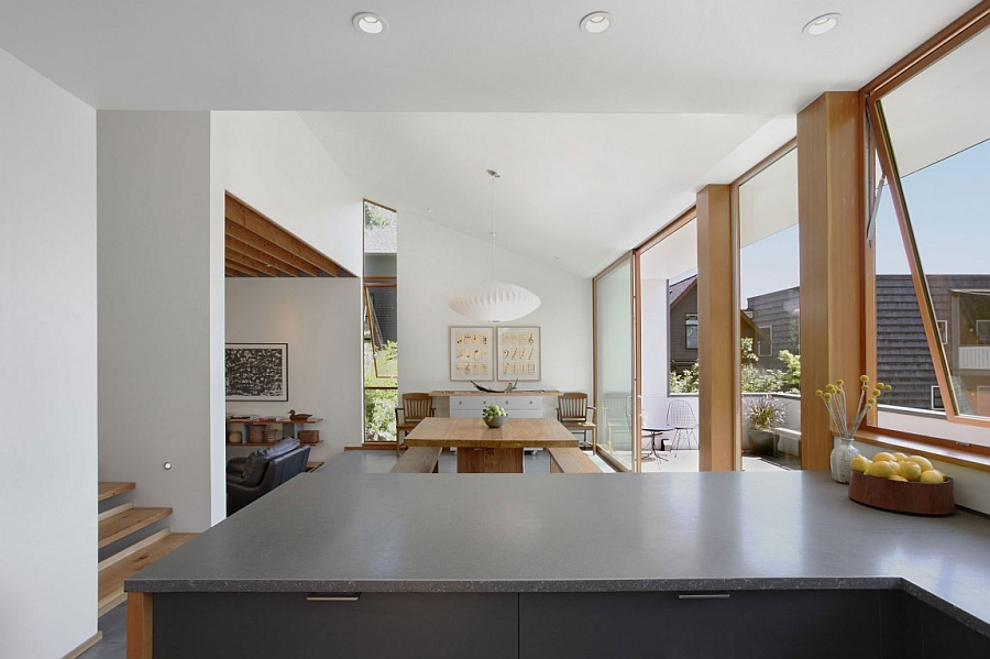 Breezy dining and kitchen areas connected with the terrace outside