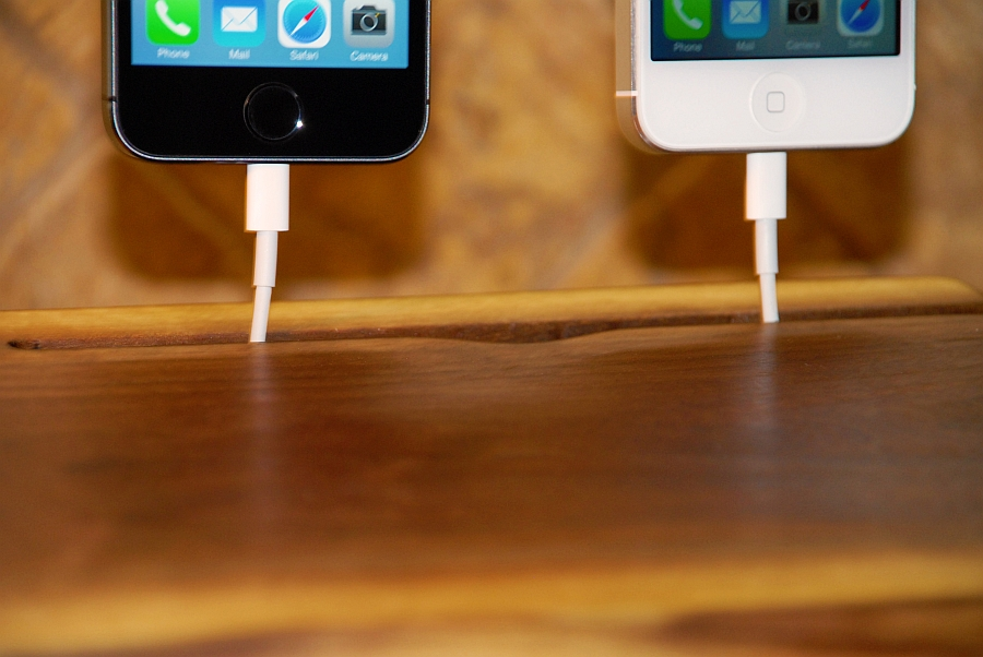 Charge your smartphones at the stylish wooden dock