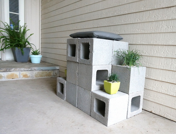 Cinder block throne with plants and a cushion