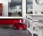 Contemporary bathroom with red bathtub