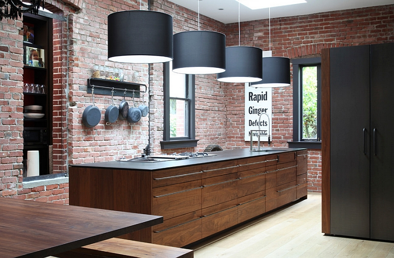 Contemporary kitchen with expoosed brick wall