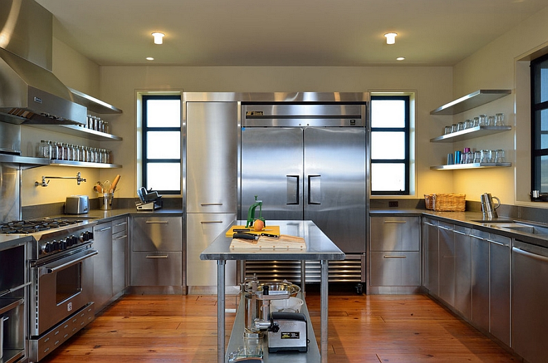 Contemporary kitchen with shiny stainless steel surfaces