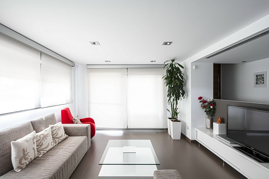 Contemporary living room in white and grey with red accents