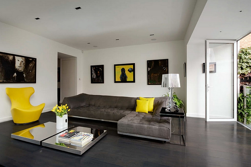 Contemporary living room with cool table lamp and pops of yellow accents