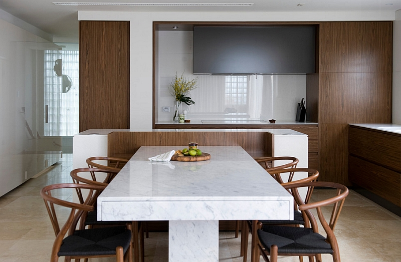 Cool Wishbone chairs coupled with a simple, marble top dining table