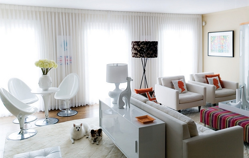 Dark floor lamp makes a bold statement when placed in a white contemporary living room