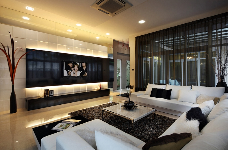Dark sheer curtains provide visual contrast in this posh living room