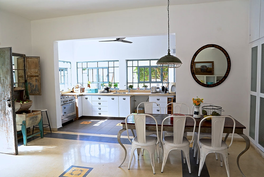 Dining area and kitchen of the renovated home Renovated Israeli Home Uses Recycled Decor To Usher In Rustic Chic