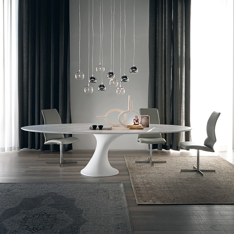 Dining table inspired by the form of iconic Tulip Table