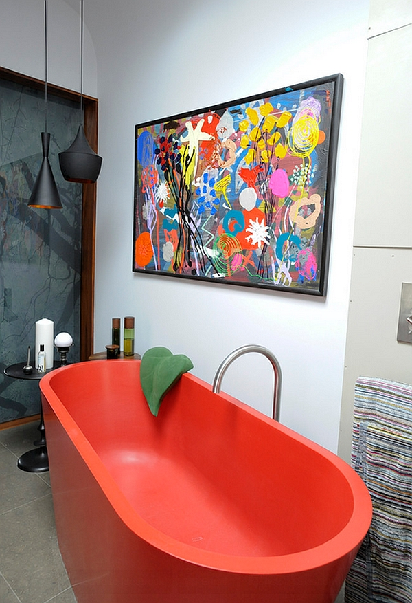 Eclectic bathroom with red standalone tub and Tom Dixon Lighting