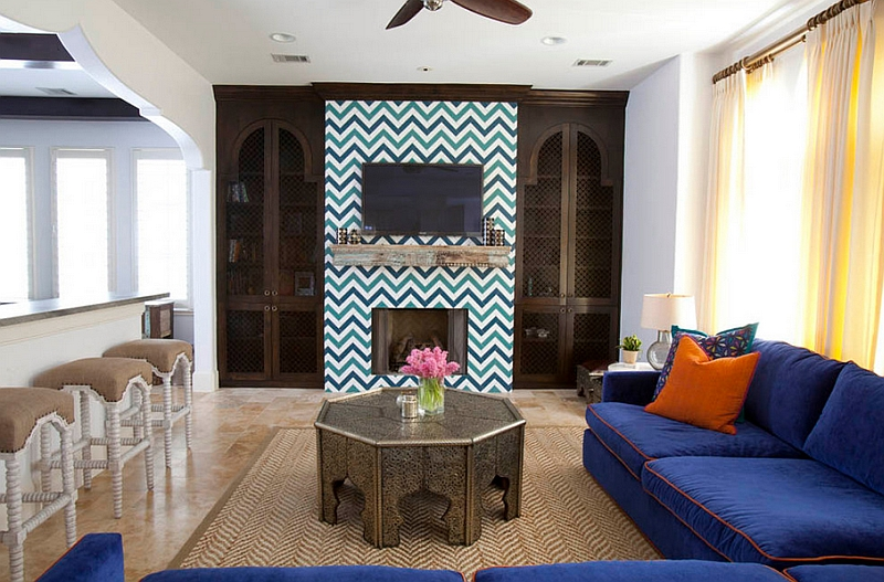 Eclectic living room with bold zigzag tile around the fireplace