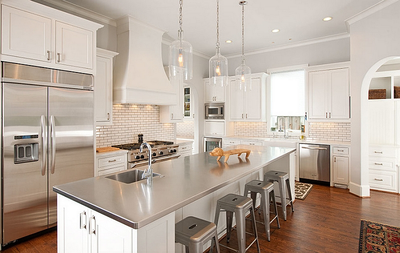 Elegant kitchen in white with a modern stainless steel island
