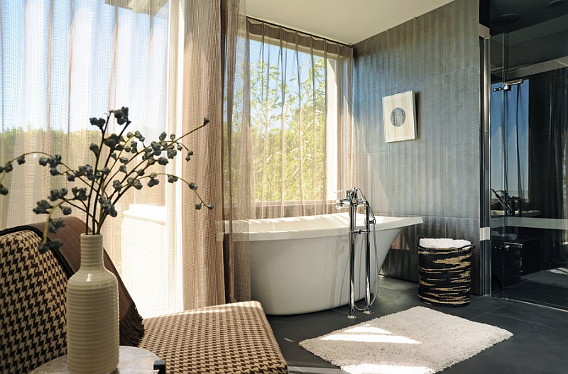 Elegant sheer curtains seem like a perfect idea for the lavish contemporary bathroom
