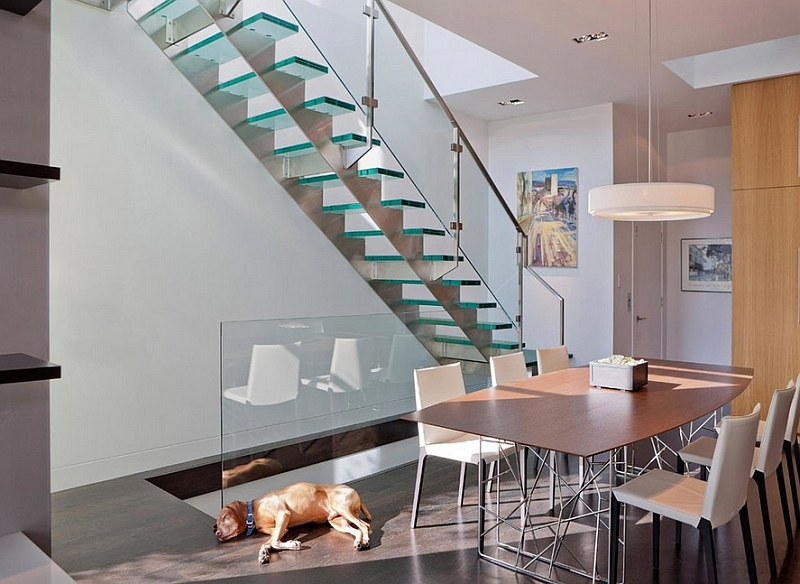 Exclusive glass stairs becomes the focal point in this modern dining room
