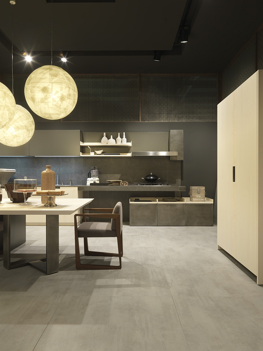 Exposed concrete and wooden surfaces shape the urban chic kitchen