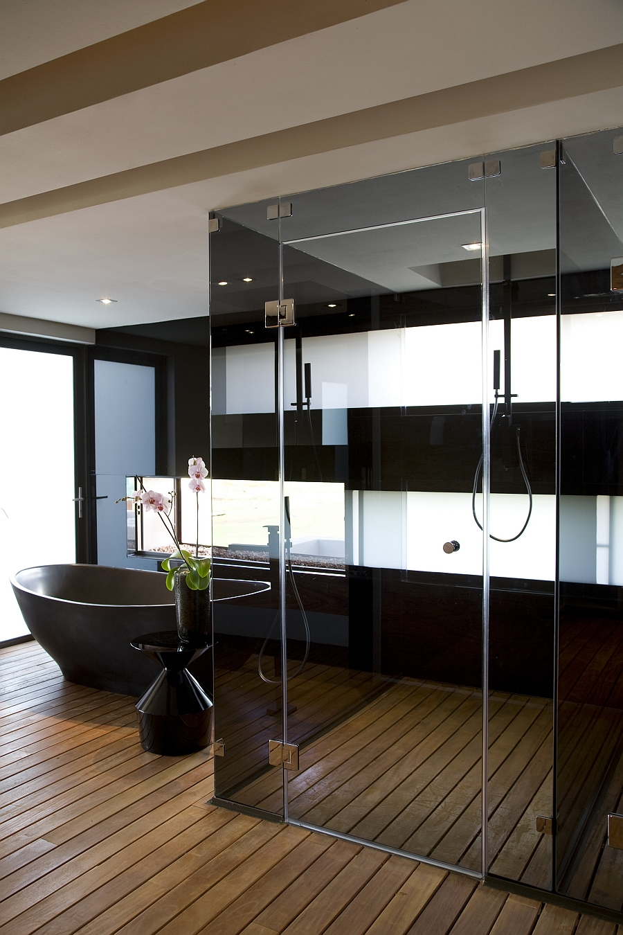 Exqusite bathroom with glass shower area
