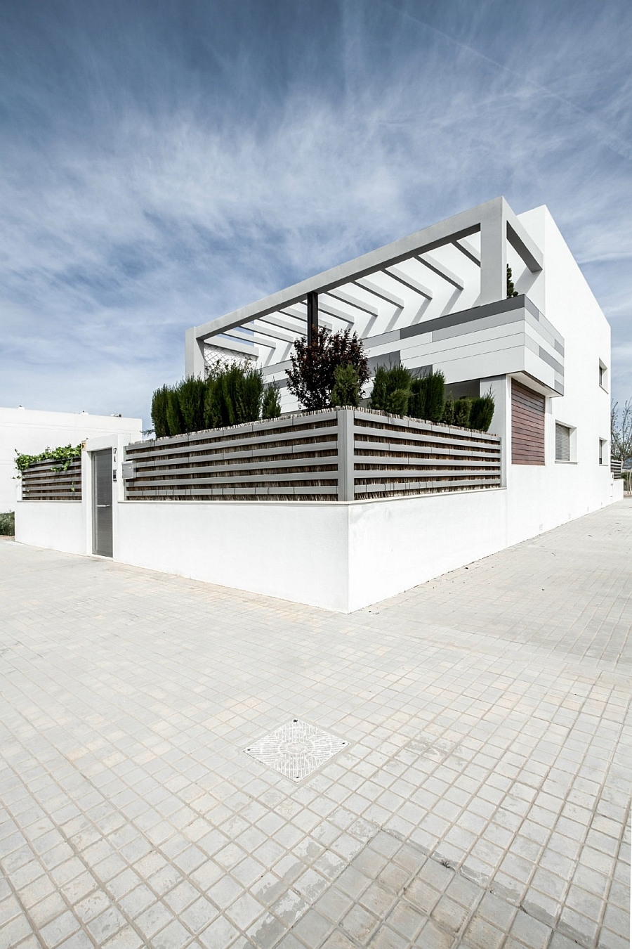 Exterior of the contemporary Spanish home in white