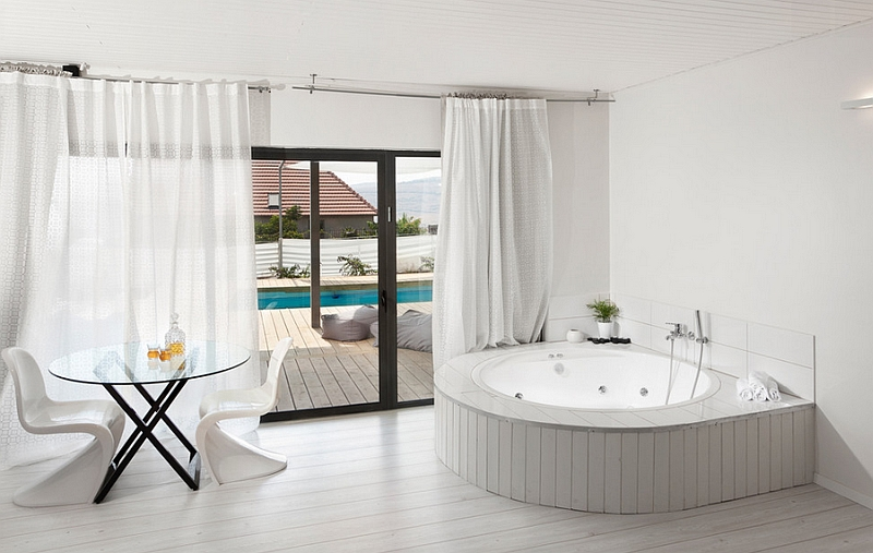 Fabulous bathroom in pristine white witha  round tub