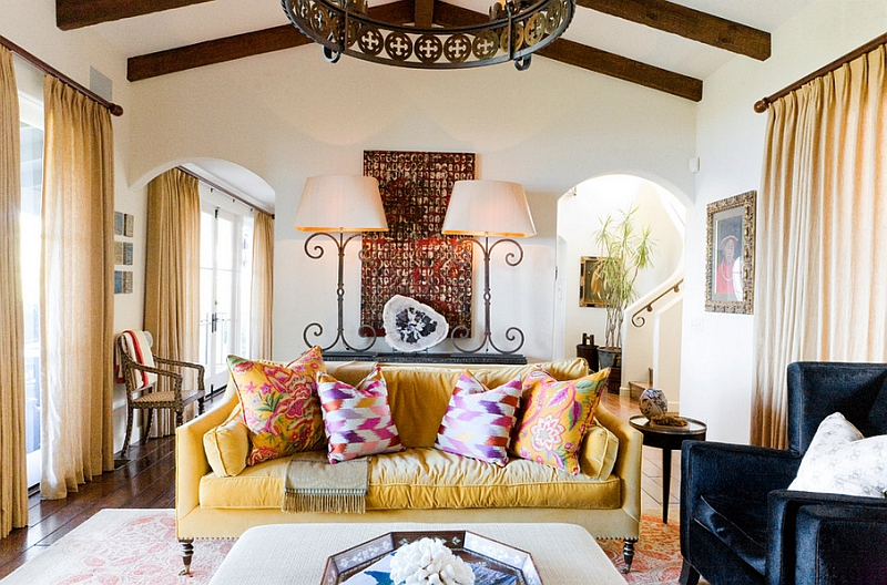 Giant table lamps incorporate some Spanish architectural flair to the room