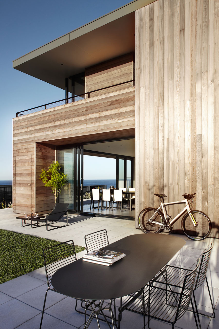 Glass doors connect the outdoors with the interior