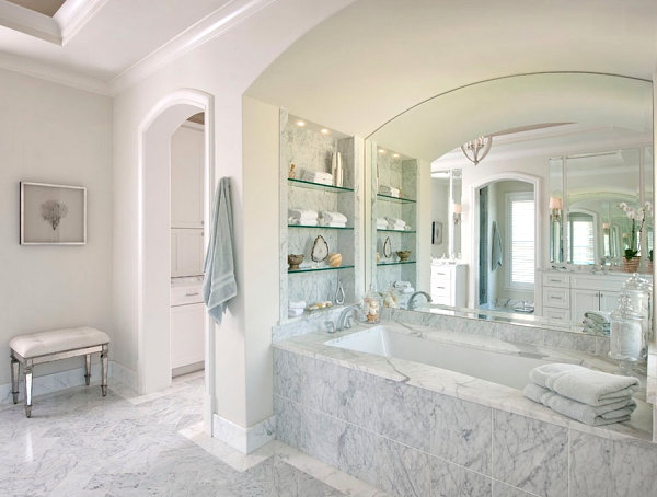 Glass shelves in a spa-style bathroom