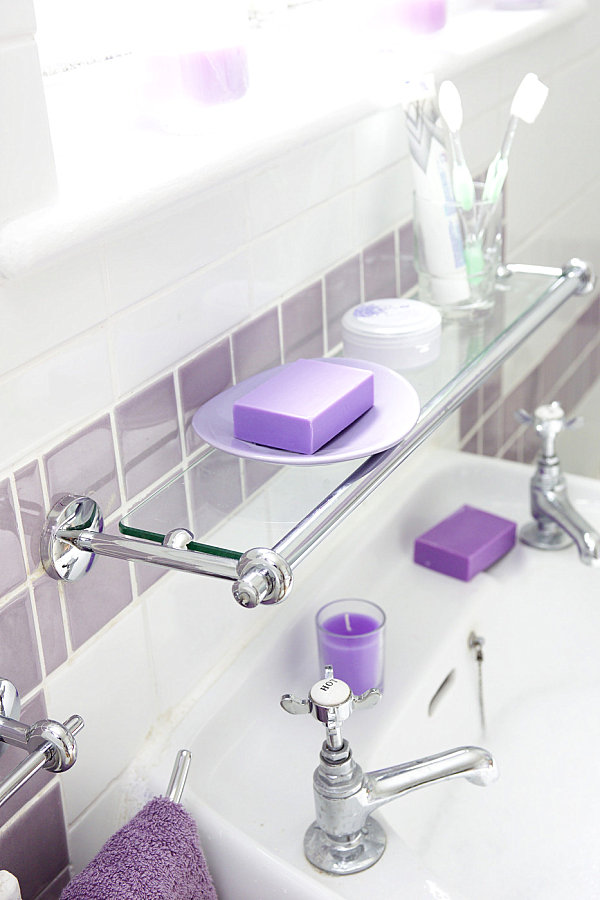 Glass shelving above a bathroom sink