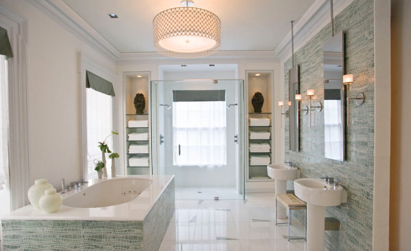 Glass shelving helps create symmetry in a bright powder room