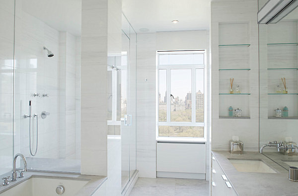 Glass shelving in a light and airy bathroom