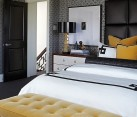 Golden yellow accents in the Black and White Bedroom
