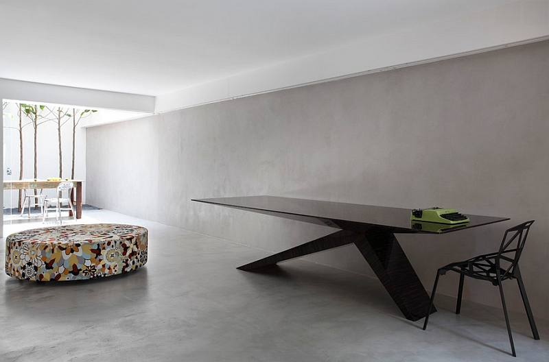 Gorgeous minimalist dining space with a sleek black table
