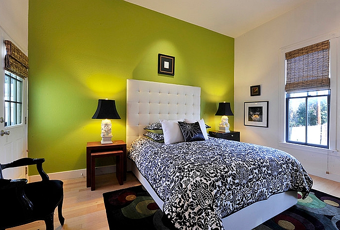 Green accent wall in the black and white bedroom