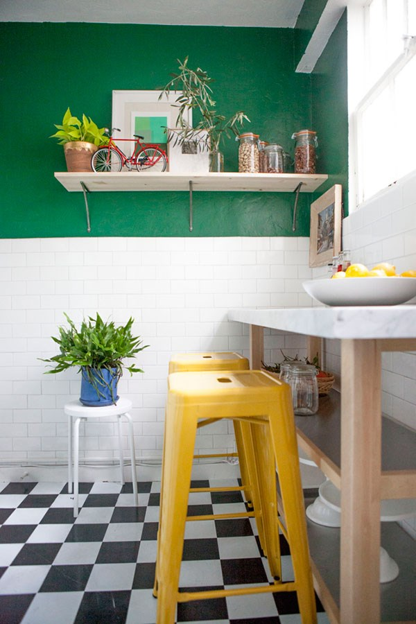 Green kitchen with yellow accents