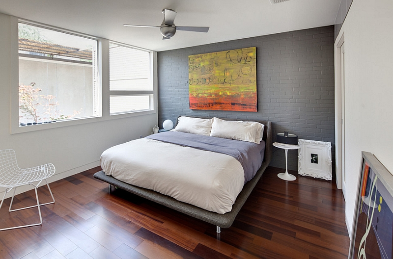 Grey accent wall brings sophistication to the bedroom