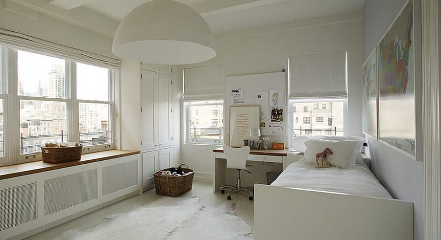 Kids' bedroom in white with a giant pendant light