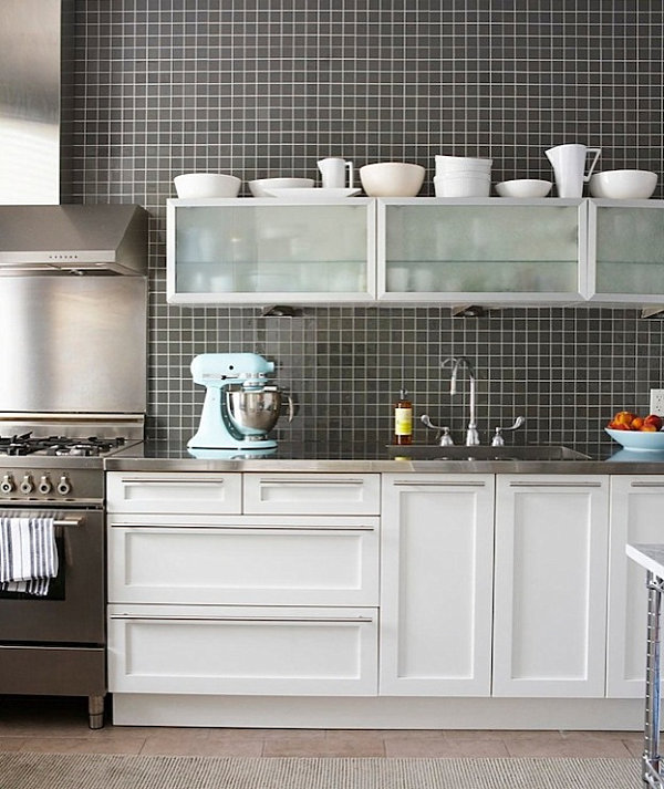 Kitchen with stainless steel countertops and a black grid backsplash