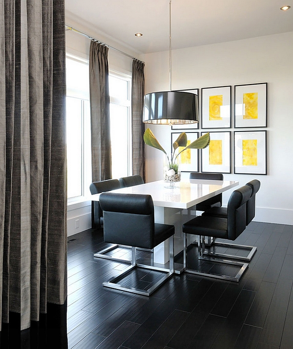 Large black pendant turns the dining space into an instant focal point