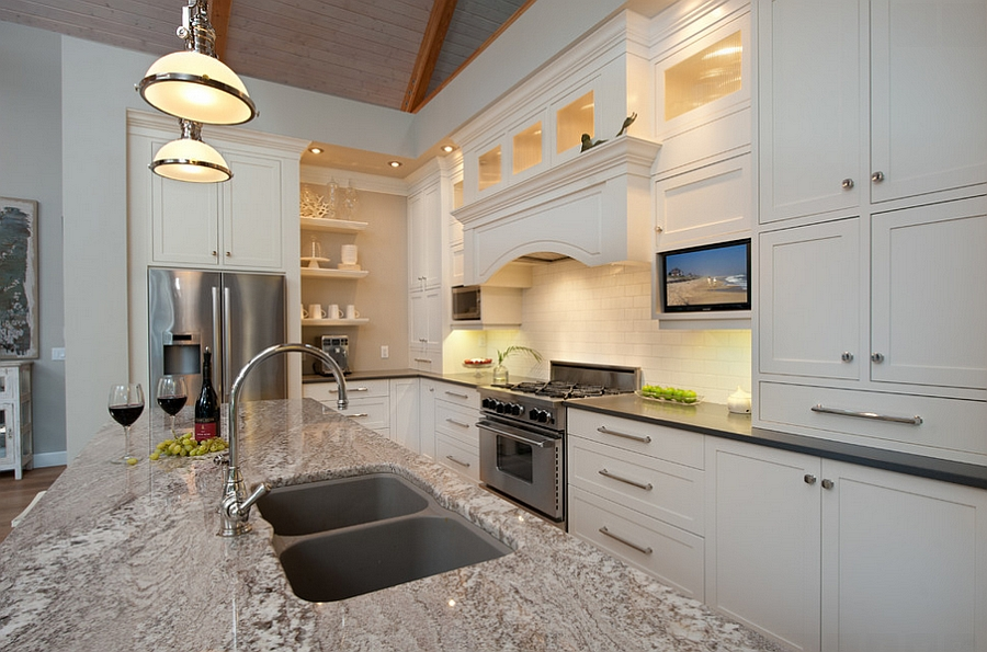 Large kitchen island with granite countertop and two sinks