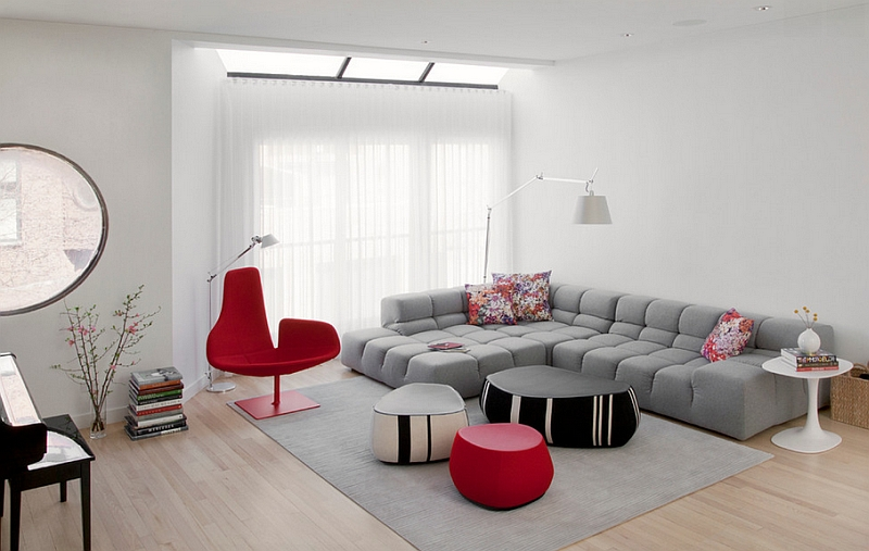 Minimal living room with bright accents of red and the Fjord chair