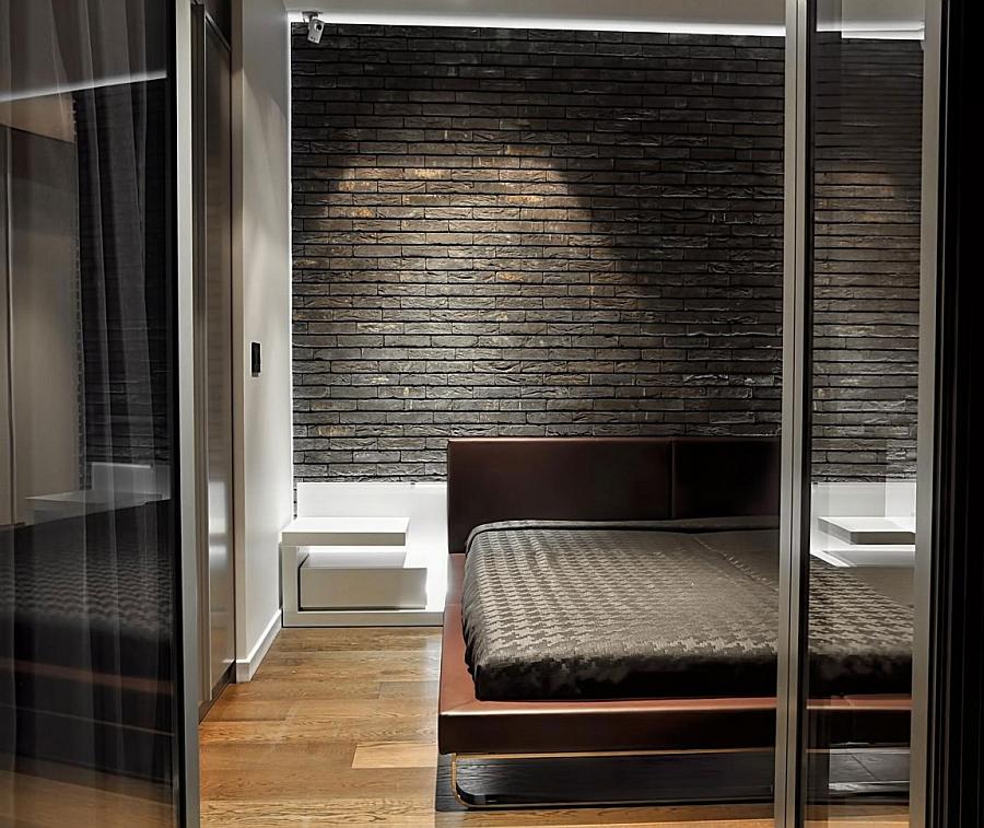 Minimal, modern bedroom in dark hues