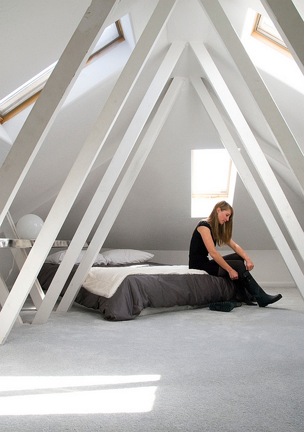 Minimalist attic bedroom with skylights