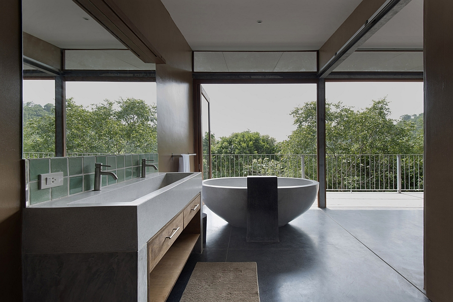 Modern bathroom with standalone tub and a view of the outdoors