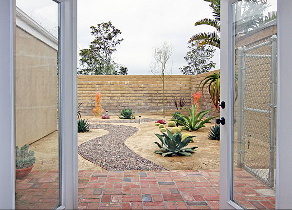Modern xeriscaped yard with colorful plants