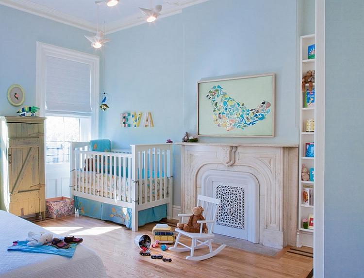 Nursery in blue with bird-themed wall art
