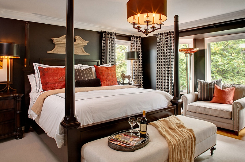 Orange accents for the black and white bedroom