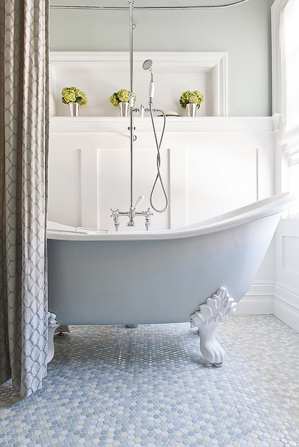 Painted clawfoot tub and mulitcolored penny flooring give this bathroom a tranquil vibe