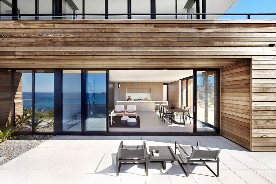 Patio connected with the dining area and the kitchen Breathtaking Ocean Views And A Distinct Facade Shape The Lamble Residence