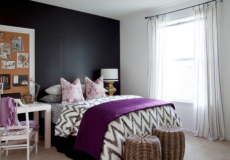 Plush purple accents in the black and white bedroom