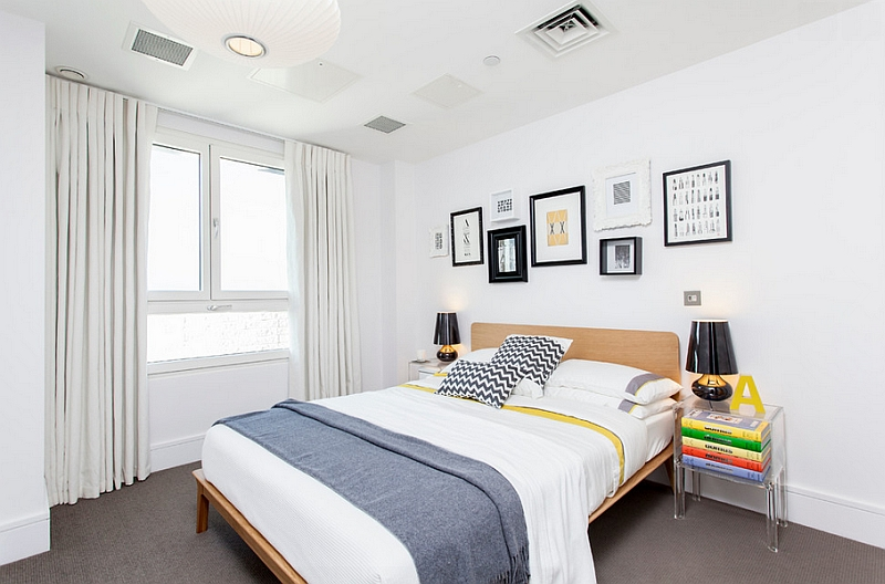 Predominantly white bedroom with smart pops of color
